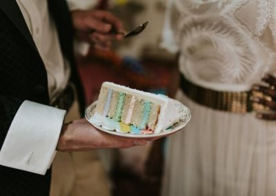 close up of cake with rainbow icing filling