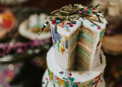 close up of rainbow cake with glitter