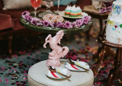pink ceramic horse entertaining two dessert plates
