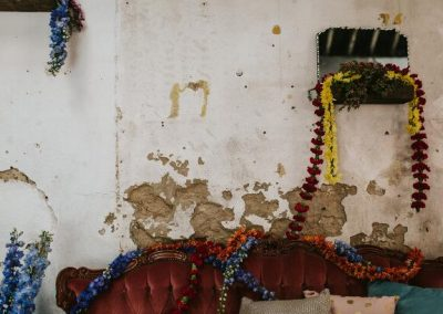detailed shot of damaged concrete wall and colourful floral arrangement