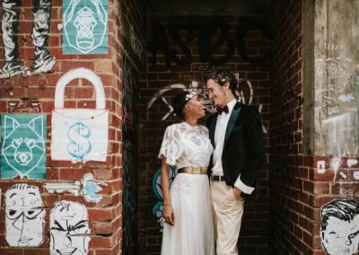 bride and groom having a laugh in a laneway