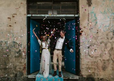 bride and groom celebrating with confetti