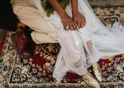 close up of bride sitting on grooms knee