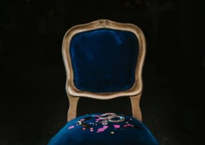 blue velvet dining chair with confetti on seat