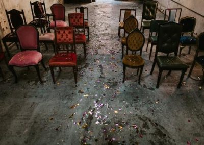 ceremony setup with confetti on concrete floor