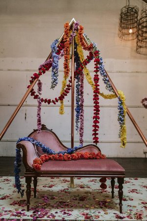 rosario pink settee draped with flowers