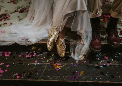 close up of brides and grooms shoes