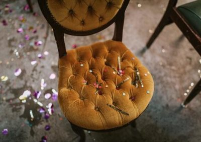 glitter confetti on mustard dining chair