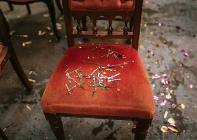 glitter confetti on orange dining chair